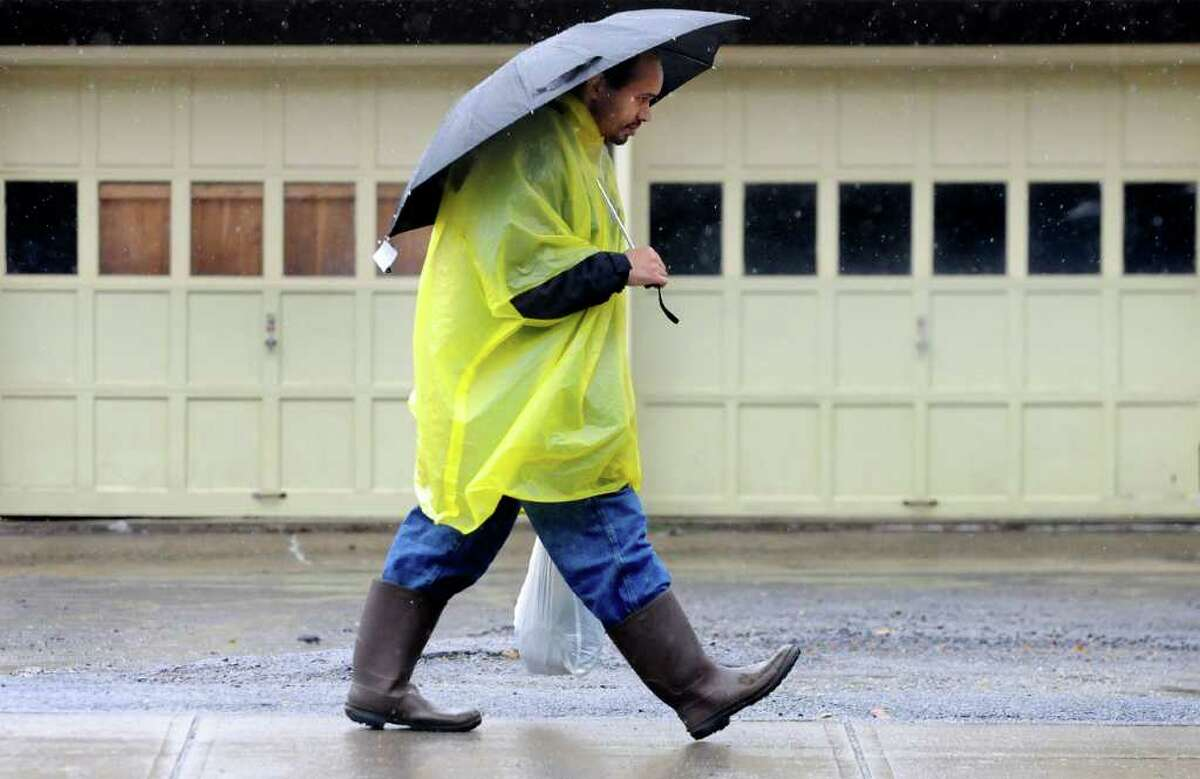 Justin Brennan of Schenectady is fully dressed for a rainy day as he walks home on Wednesday, Oct. 6, 2010, in Schenectady, N.Y. (Cindy Schultz / Times Union)