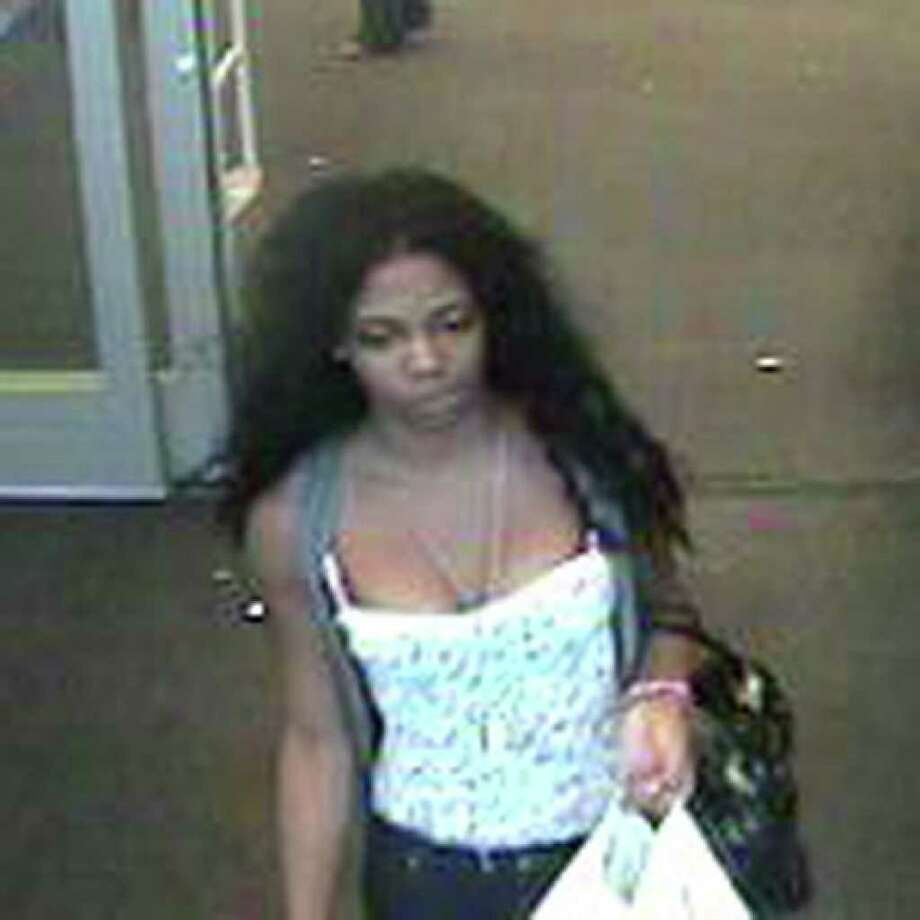 Police are seeking the public's help in identifying a woman caught on video surveillance using a credit card stolen from the Fairfield Cinemas in July. Photo: Contributed Photo / Fairfield Citizen contributed