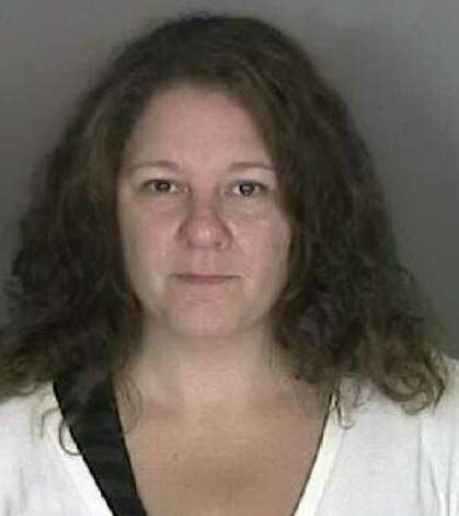 Kristina Stuto, 40, of Albany, who works in the state Health Department?s Bureau of Administrative Services, allegedly made $7,900 in improper purchases using a state travel credit card between 2009 and 2010. She was charged Wednesday with felony grand larceny.