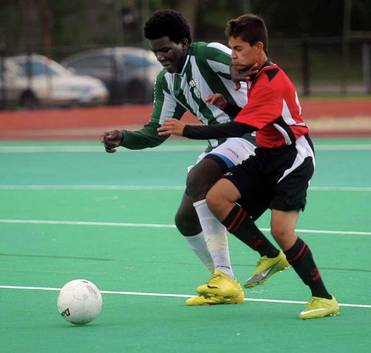Jairo Escamilla of Bassick, left, and Central's Carlos Araque, right, compete for control of the ball during Wednesday's game at Bridgeport Central High School on September 6, 2010.