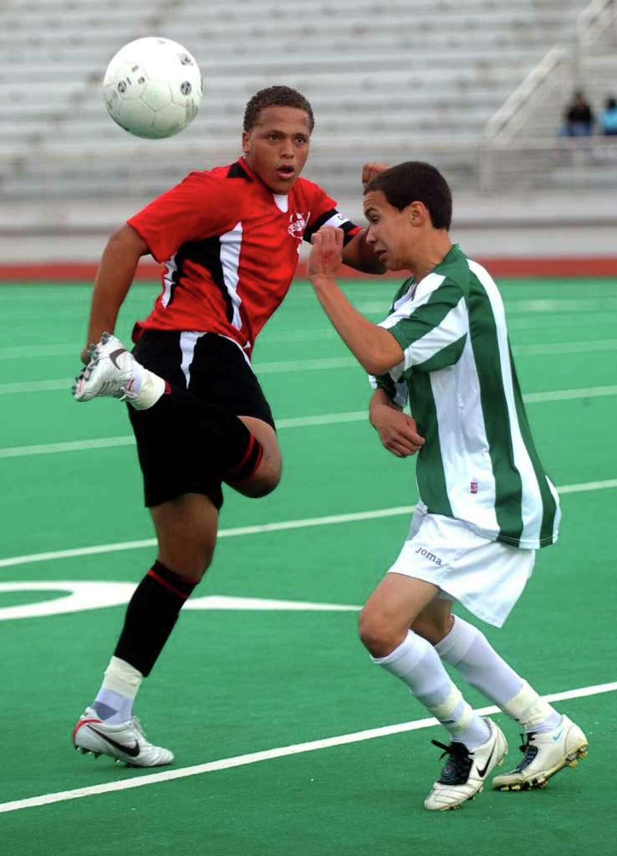 Central's Jenilo Soares, left, and Josue Lopez, right, compete for control of the ball during Wednesday's game at Bridgeport Central High School on September 6, 2010.