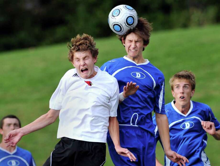 Mike Flippin of the Greenwich High School soccer team reacts as he tries for a header which is taken by Ben Hall of the Darien High School soccer team during the Greenwich High School vs. Darien High School soccer match at GHS, Wednesday afternoon, Oct. 6, 2010.  GHS won the match 2-1. Photo: Bob Luckey / Greenwich Time