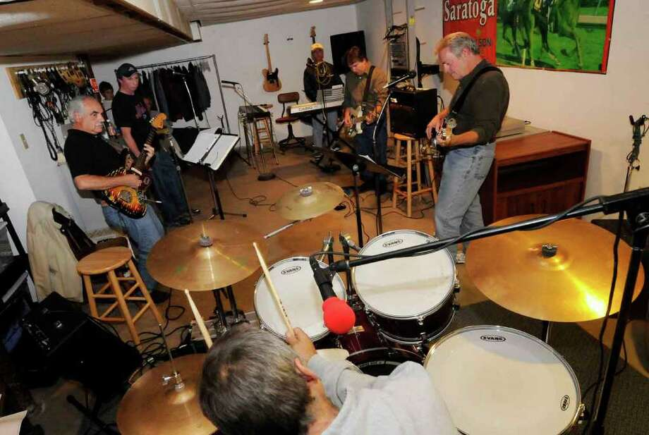 The band the Chord-A-Roys, reformed from the 1960s, practice in the basement of drummer Jim Rocco's Guilderland home for an upcoming class of 1970 dance party at the All Saints Parish Center in  Albany 10/06/2010. (Michael P. Farrell / Times Union) Photo: Michael P. Farrell