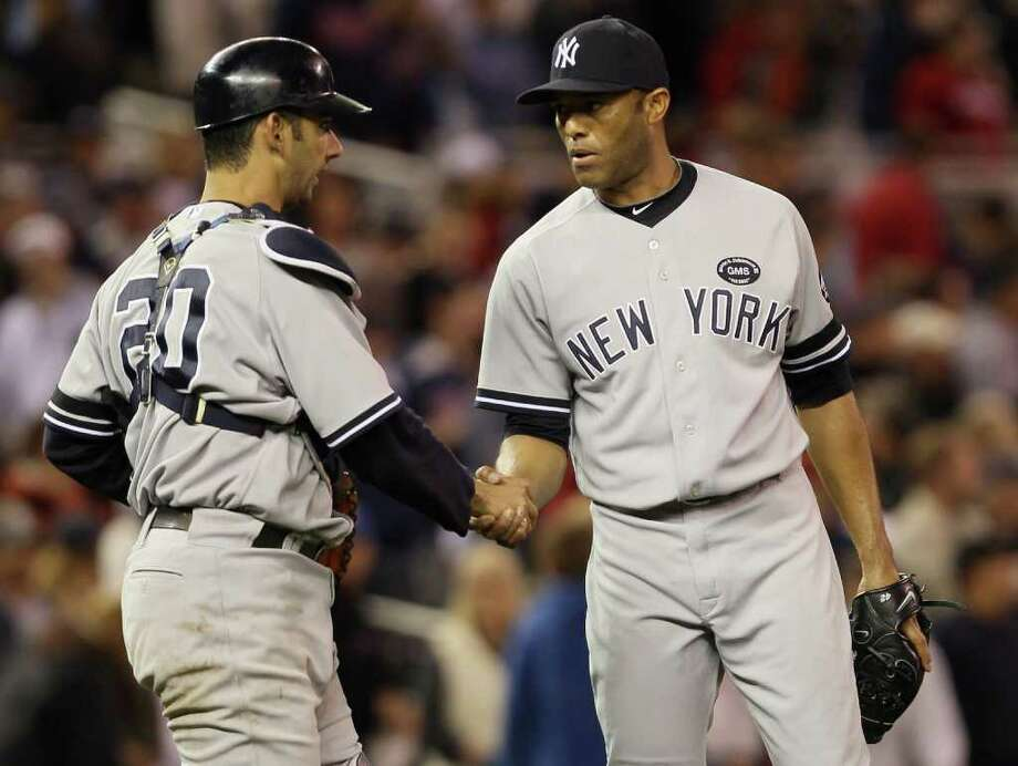 MINNEAPOLIS - OCTOBER 06:  Mariano Rivera #42 of the New York Yankees celebrates the win with teammate Jorge Posada #20 after game one of the ALDS against the Minnesota Twins on October 6, 2010 at Target Field in Minneapolis, Minnesota. The Yankees defeated the Twins 6-4.  (Photo by Elsa/Getty Images) *** Local Caption *** Mariano Rivera;Jorge Posada Photo: Elsa, Getty Images / 2010 Getty Images