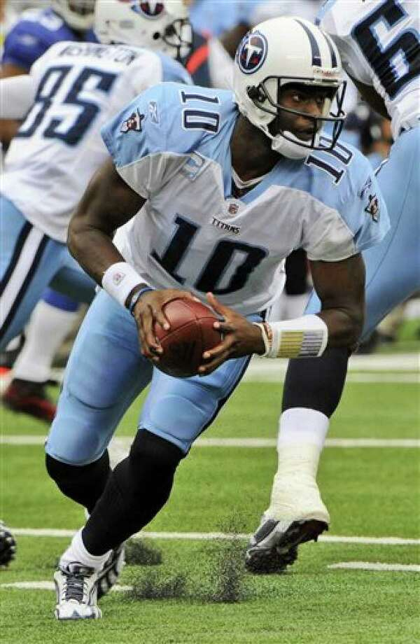 Titans quarterback Vince Young scrambles against the Giants on Sept. 26.