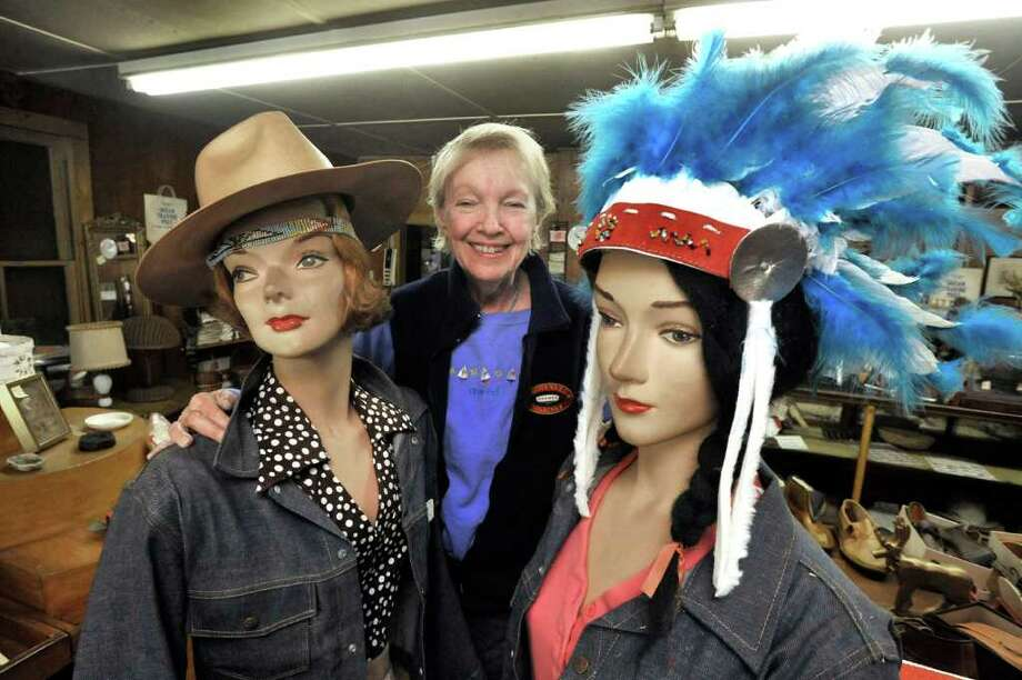 B B Jackson stands between two mannequins at the Indian Trading Post in Danbury, Wednesday, Oct. 6, 2010. Photo: Michael Duffy / The News-Times