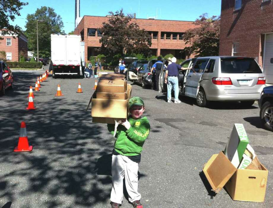 A six-year-old volunteer helped out with Shred Day, which took place at the Fairfield Police Department Saurday. Funds raised from the event will benefit the Fairfield Explorer Post 279. The Explorer program exposes young children and adults (ages 13-22) to the vast career choices available in law enforcement today. More than five tons of documents were collected and shredded Saturday. Photo: Contributed Photo / Fairfield Citizen contributed