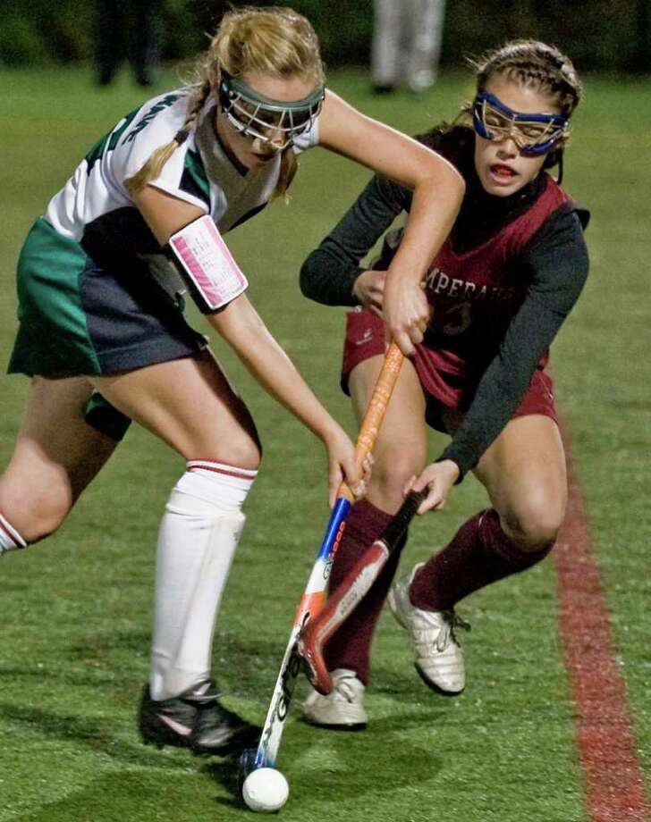 New Milford's Alexa Pearl and Pomperaug's Sarah McVerry fight for the ball during a field hockey game at Weston. Thursday Nov. 5, 2009 Photo: Scott Mullin / The News-Times