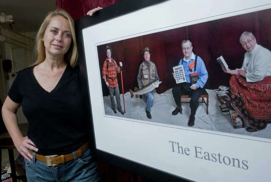 Professional photographer Catherine Easton Grandt of Redding with her photograph of her family. Thursday, Oct. 7, 2010 Photo: Scott Mullin / The News-Times Freelance