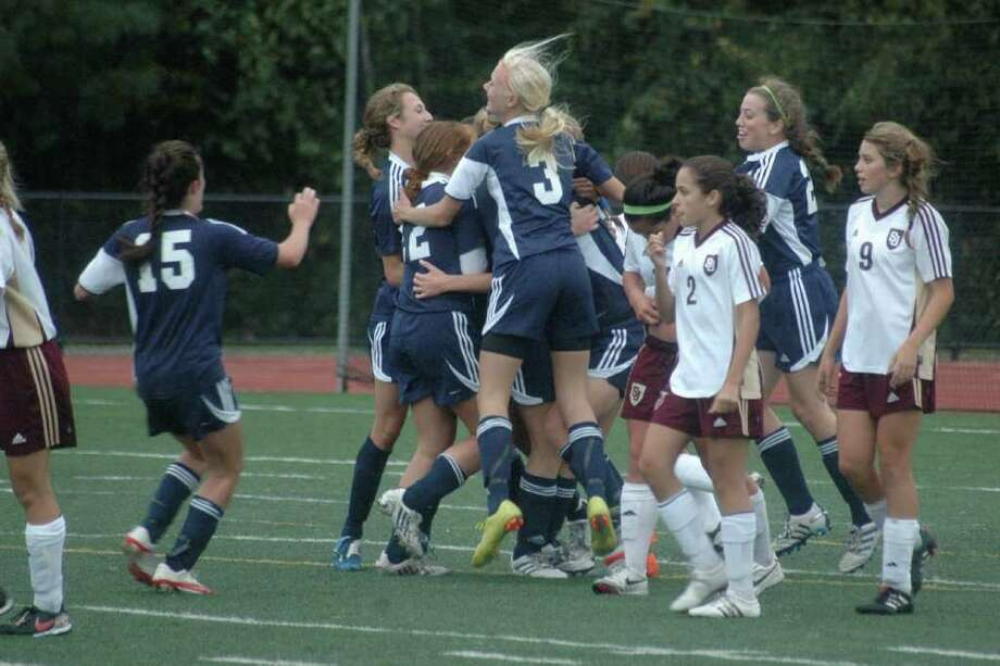 Staples celebrates after taking a 1-0 lead at St. Joseph on Tuesday. St. Joseph tied the game in the waning seconds as the Lady Wreckers and St. Joe's ended their game in a 1-1 tie. Photo: Contributed Photo / Craig Moss