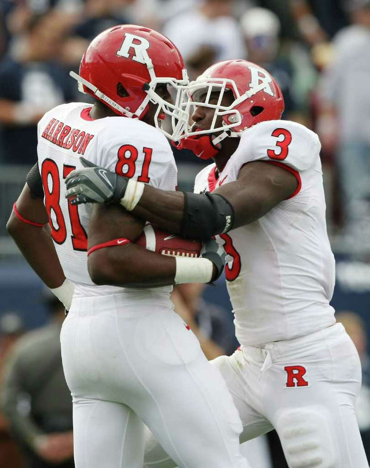 EAST HARTFORD, CT - OCTOBER 31: Mark Harrison #81 of the Rutgers Scarlet Knights celebrates his touchdown with teammate Shamar Graves #3 in the second half against the Connecticut Huskies on October 31, 2009 at Rentschler Field in East Hartford, Connecticut. (Photo by Elsa/Getty Images) *** Local Caption *** Mark Harrison;Shamar Graves