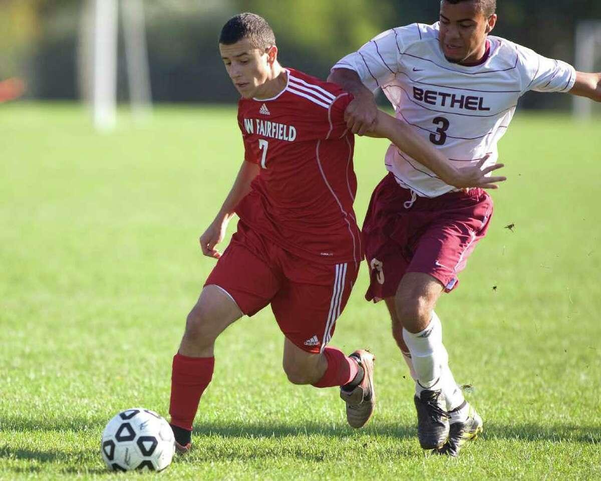 New Fairfield's Matt Tryforos (7) battles to get around Bethel defender Pedro Alves during their SWC match Thursday at Bethel High.