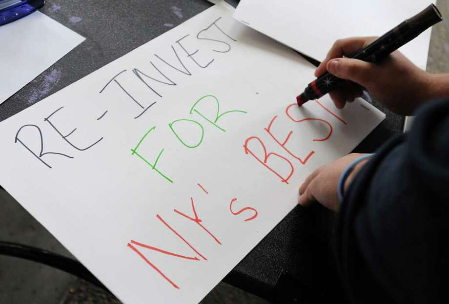 A student makes a sign during a protest over the cuts in public education at the campus center at UAlbany in Albany, NY, on October 7, 2010.  (Lori Van Buren / Times Union) Photo: Lori Van Buren