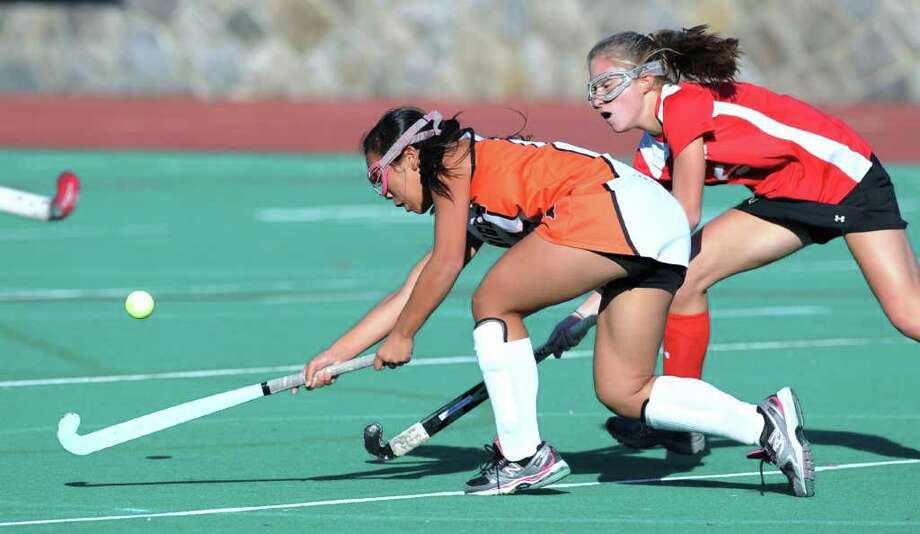 Jasmine Li, # 3, of Stamford High School, left, in action against Jennifer Renz, # 5 of Greenwich High School, right,  during the game between the Greenwich High School field hockey team vs. the Stamford High School field hockey team at Stamford High School, Oct. 7, 2010. Photo: Bob Luckey / Greenwich Time