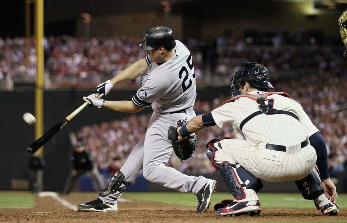 MINNEAPOLIS - OCTOBER 07: Mark Teixeira #25 of the New York Yankees gets a hit as Joe Mauer #7 of the Minnesota Twins catches during game two of the ALDS on October 7, 2010 at Target Field in Minneapolis, Minnesota. (Photo by Elsa/Getty Images) *** Local Caption *** Mark Teixeira