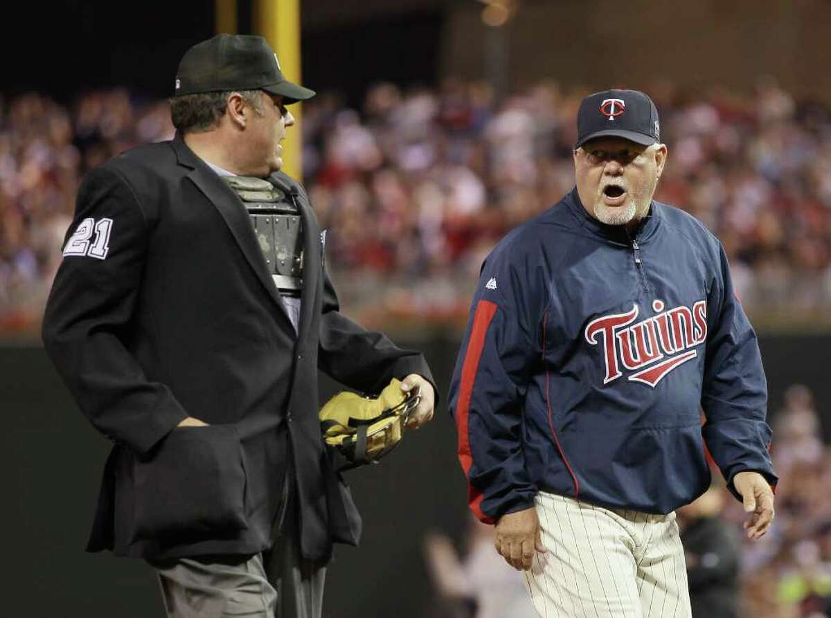 MINNEAPOLIS - OCTOBER 07: Manager Ron Gardenhire #35 of the Minnesota Twins is ejected from the game by Hunter Wedelstedt in the seventh inning against the New York Yankees during game two of the ALDS on October 7, 2010 at Target Field in Minneapolis, Minnesota. (Photo by Elsa/Getty Images) *** Local Caption *** Ron Gardenhire;Hunter Wedelstedt