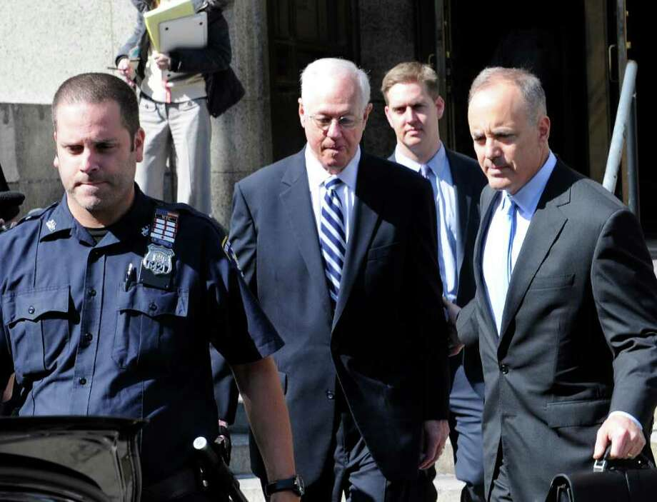 Former New York Comptroller Alan Hevesi, center, exits Manhattan criminal court following his arraignment, Thursday, Oct. 7, 2010, in New York. Hevesi pleaded guilty to a felony tied to New York Attorney General Andrew Cuomo's probe of corruption at the state's pension fund. (AP Photo/Louis Lanzano) Photo: Louis Lanzano
