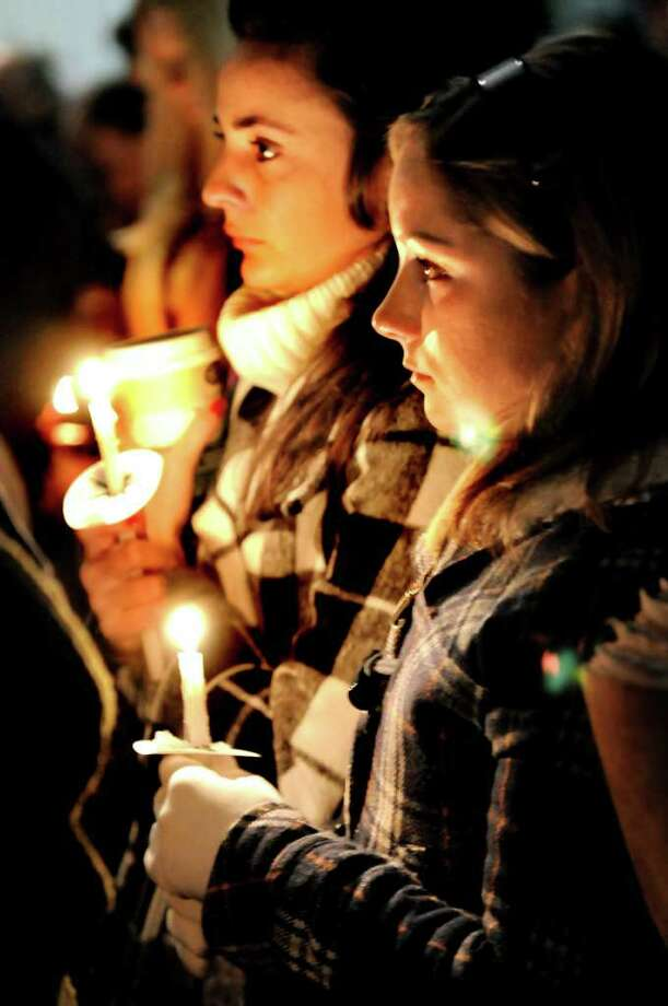 University at Albany students Katie Casares, right, and Alison Siegel, left, attend a candle-light vigil for their their friend Richard Bailey on Wednesday, Oct. 22, 2008, at the University of Albany. (Cindy Schultz / Times Union) Photo: CINDY SCHULTZ / 00000866A