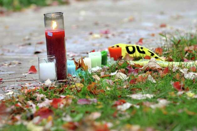 A small memorial glows on the sidewalk of South Lake Street on Wednesday, Oct. 22, 2008, in Albany, where. University at Albany student Richard Bailey was fatally shot. (Cindy Schultz / Times Union) Photo: CINDY SCHULTZ