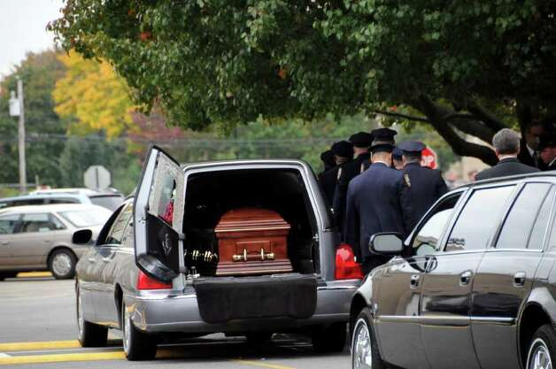 The casket of Richard Bailey is placed in a Hearse outside of St. Bernard's Church in Levittown where a funeral was held for the slain college student on Oct. 27, 2008. (Photo by James Carbone) Photo: Photo By James Carbone