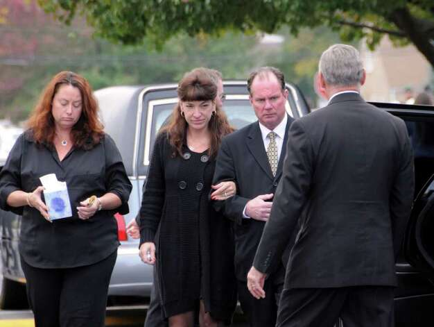 Relatives of Richard Bailey, are escorted into limo outside of St. Bernard's Church in Levittown where a funeral was held for the slain college student on Oct. 27, 2008. (Photo by James Carbone) Photo: Photo By James Carbone