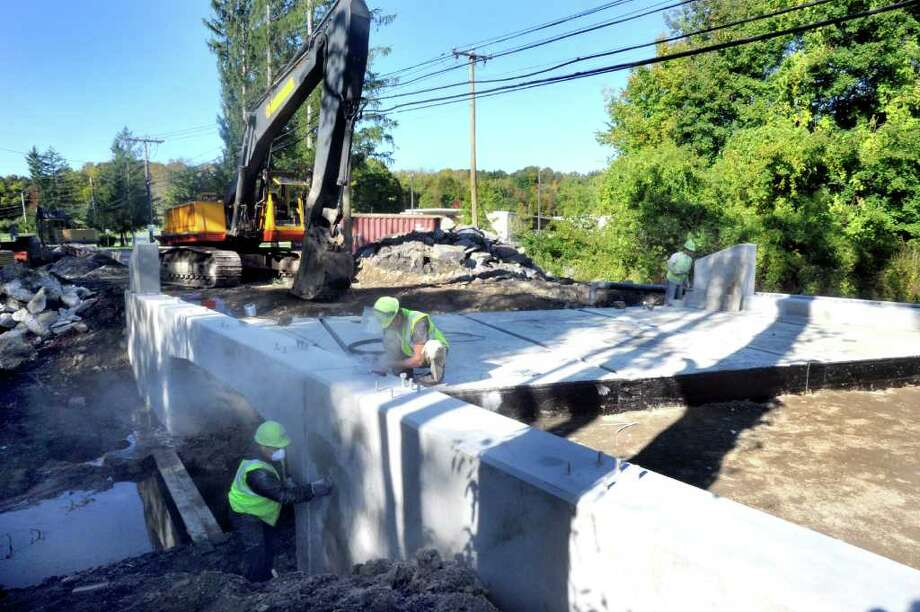 Workers grind cement on the Backus Avenue bridge in Danbury, Friday, Oct. 8, 2010. Photo: Michael Duffy / The News-Times