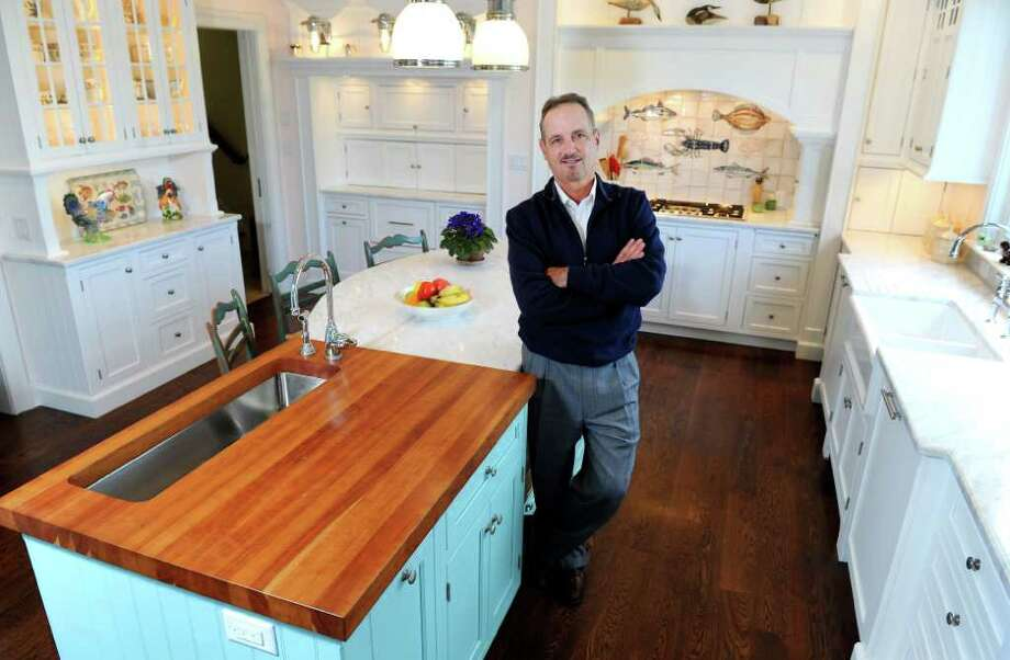 Matt Giardina, owner of Front Row Kitchens, stands in a kitchen he designed in Greenwich, Conn. on Wednesday October 6, 2010. Photo: Kathleen O'Rourke / Stamford Advocate
