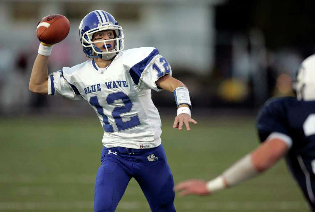 Wide eyed Darien quarterback Chris Allam looks upfield for an open receiver during a first quarter drive against Wilton.