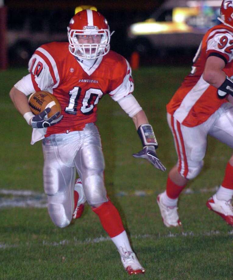 Masuk's 10, Shawn Flynn, makes his way upfield during the football game against Brookfield at Masuk Oct. 8, 2010. Photo: Chris Ware / The News-Times