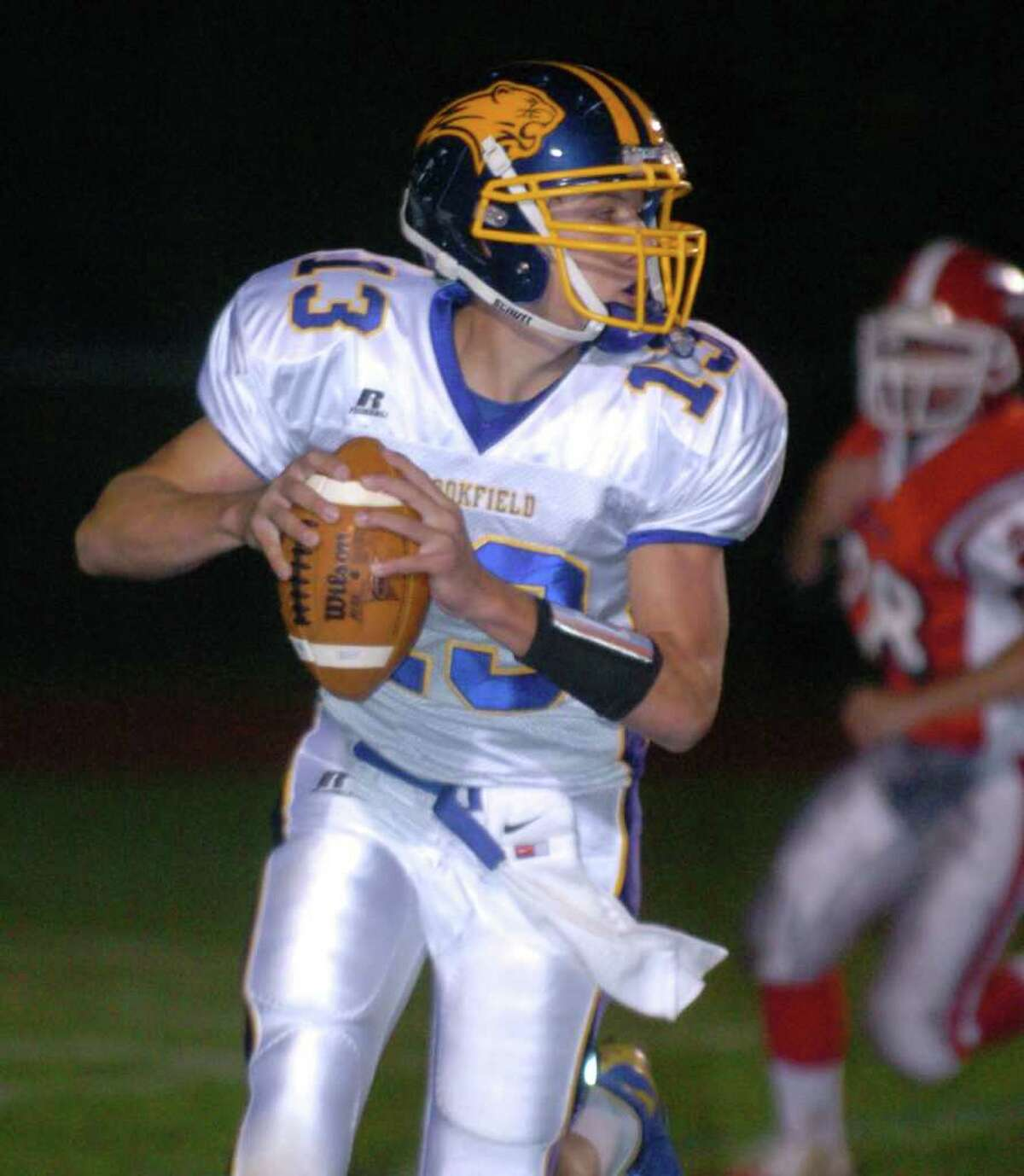 Brookfield's 13, Boeing Brown, sets up for a pass during the football game against Masuk at Masuk Oct. 8, 2010.