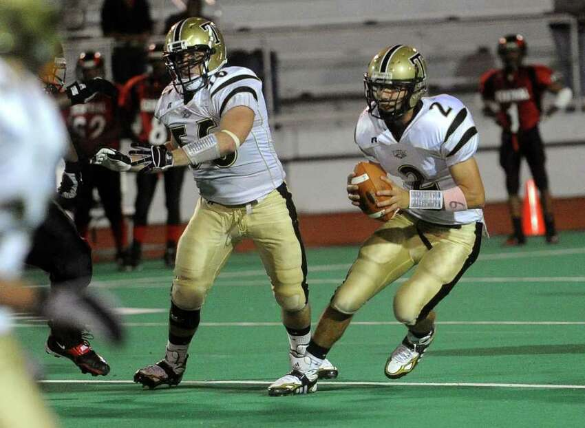 Trumbull's Phil Terio runs the ball during Friday's game at Bridgeport Central High School on October 8, 2010.