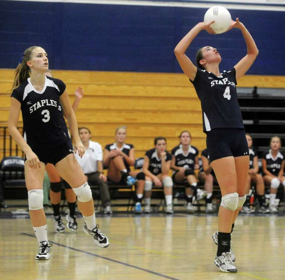 Augie Gradoux-Matt, left, watches as Staples teammate Lucy stanley sets the ball during Wednesday's game against Darien at Staples High School on September 29, 2010. volleyball Photo: Lindsay Niegelberg, ST / Connecticut Post
