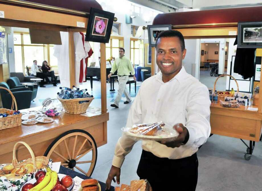 Samuel Jefferson shows up a slice of sweet potato pie at the Focus on Humanity Cafe and gift shop at the Saratoga Springs Train Station.   (John Carl D'Annibale / Times Union) Photo: John Carl D'Annibale / 00010561A