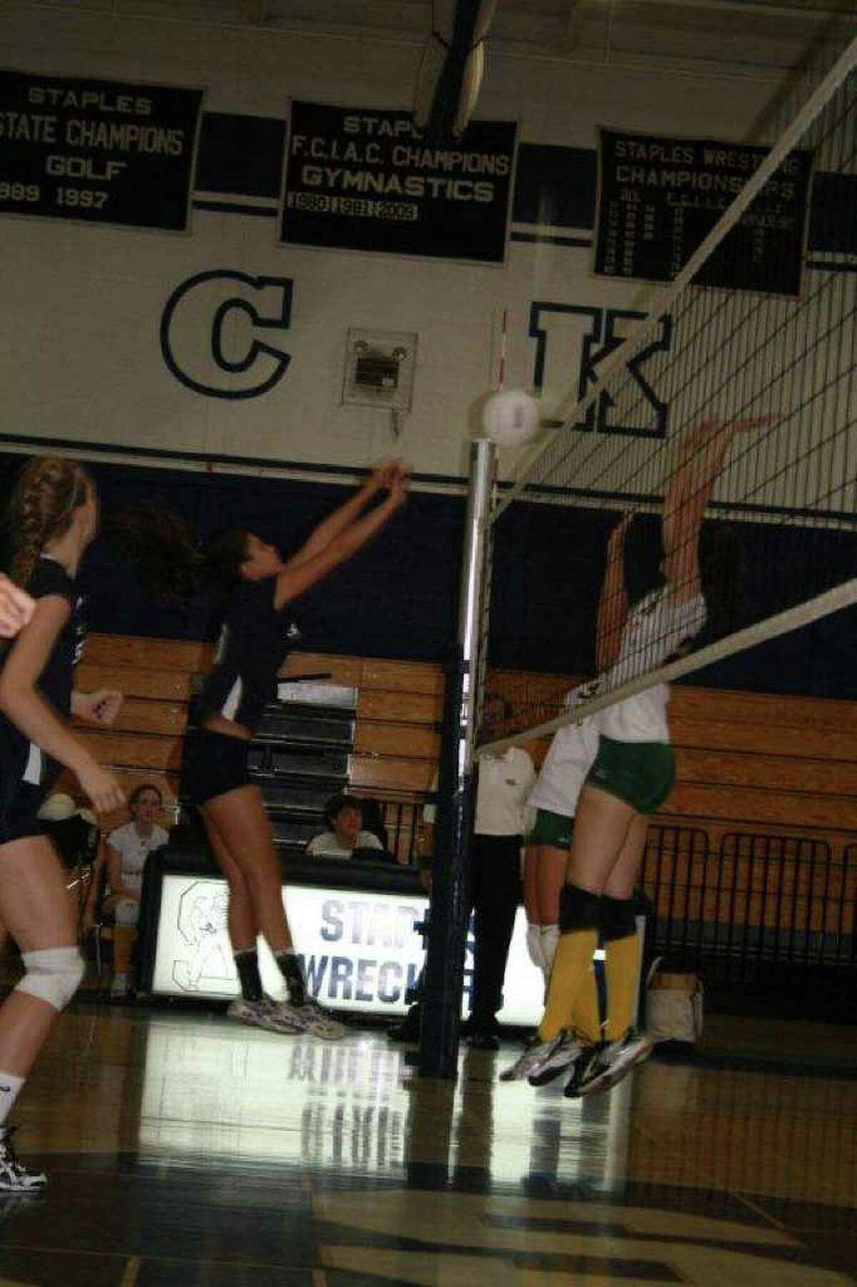 Staples senior tri-captain Alex Masiello delivers one of her 11 kills on Wednesday in a 3-0 home victory over Trinity Catholic.