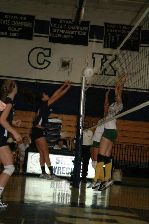 Staples senior tri-captain Alex Masiello delivers one of her 11 kills on Wednesday in a 3-0 home victory over Trinity Catholic. Photo: Contributed Photo / Karla Roof