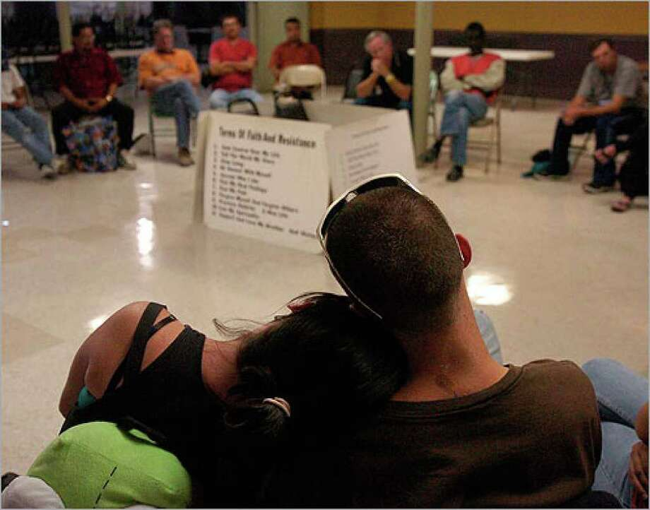 Megan Winters (left) and Candy Winters during the Wednesday prayer circle at Travis Park United Methodist Church.