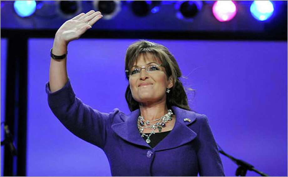 Sarah Palin greets members of the Women of Joy conference Friday at the convention center.