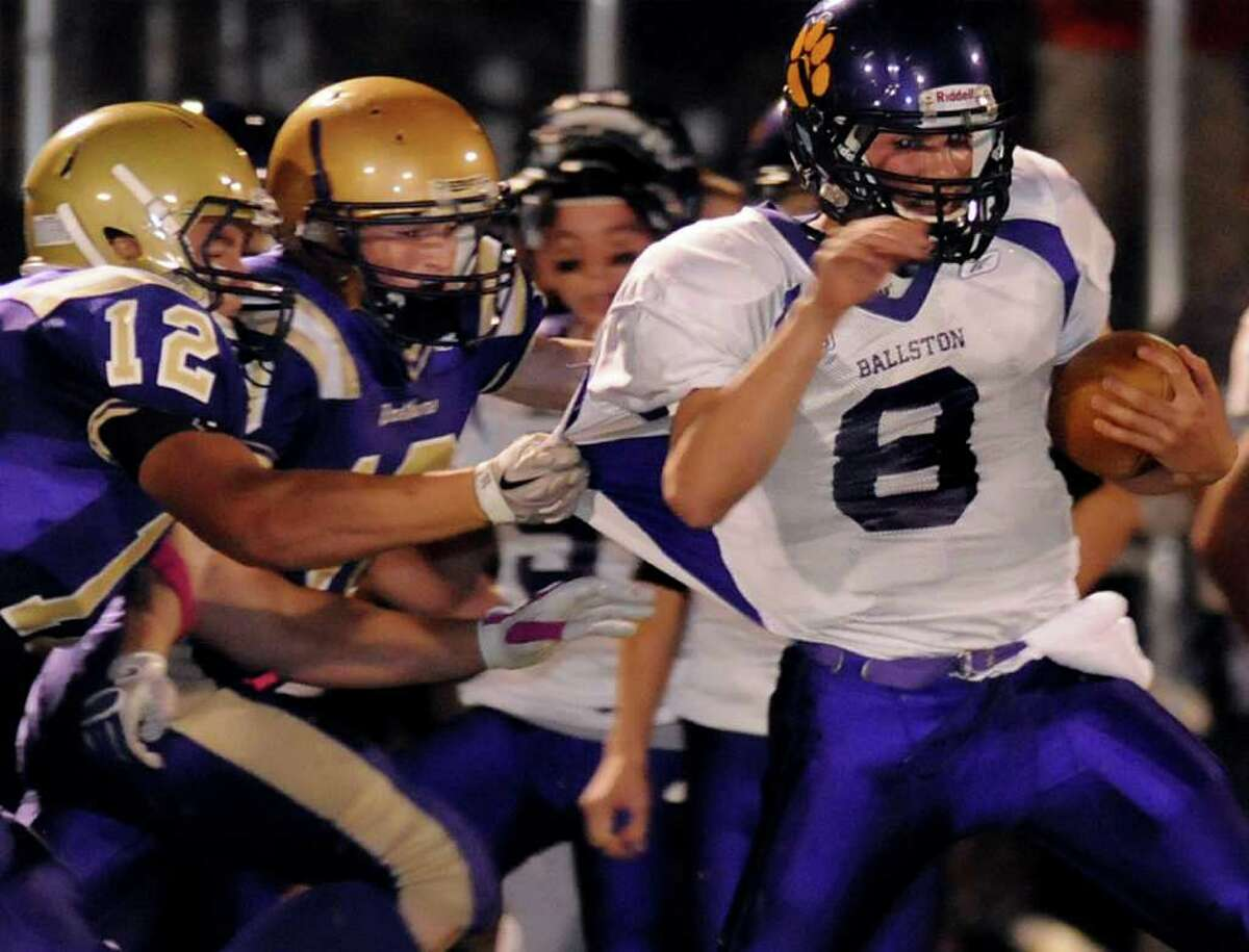 High school football -- Ballston Spa's quarterback Troy Gargiulo, right, carries the ball against the CBA defense on Friday, Oct. 8, in Colonie. (Cindy Schultz / Times Union)