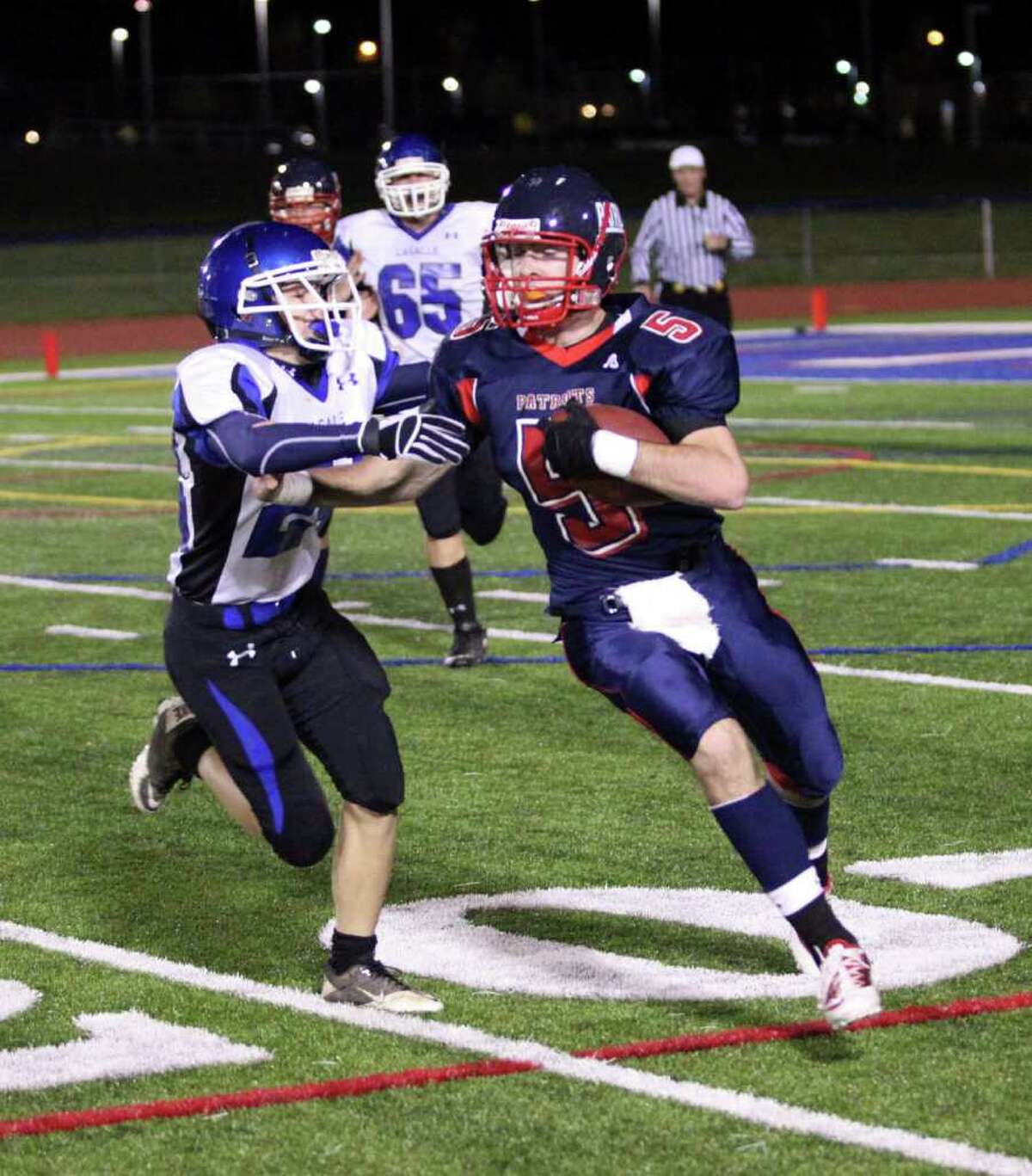 High school football -- Schenectady's Tim Cox (5) runs past La Salle's Conor Shanahan (24) on Friday Oct. 8. (Patrick Dodson / Special to the Times Union)