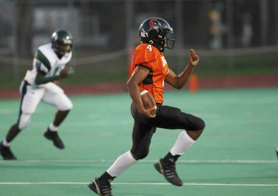 The Knights offense advance the ball late early in the first quarter of play as Stamford hosts Norwalk on Friday night under the lights on October 8th. Photo: David E. Johnston / Connecticut Post Freelance