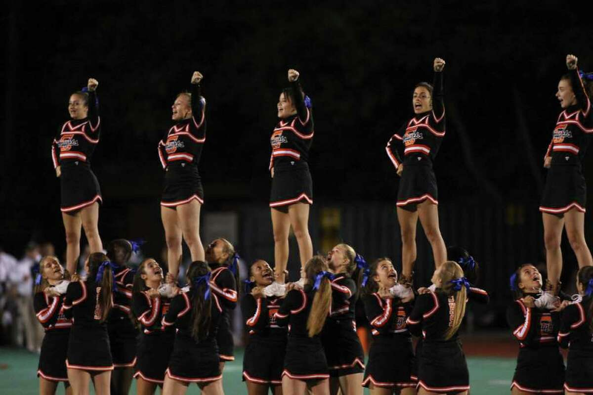 The Knights Cheerleaders entertain the crowds on Friday night under the lights as Stamford plays Norwalk Football in Stamford.