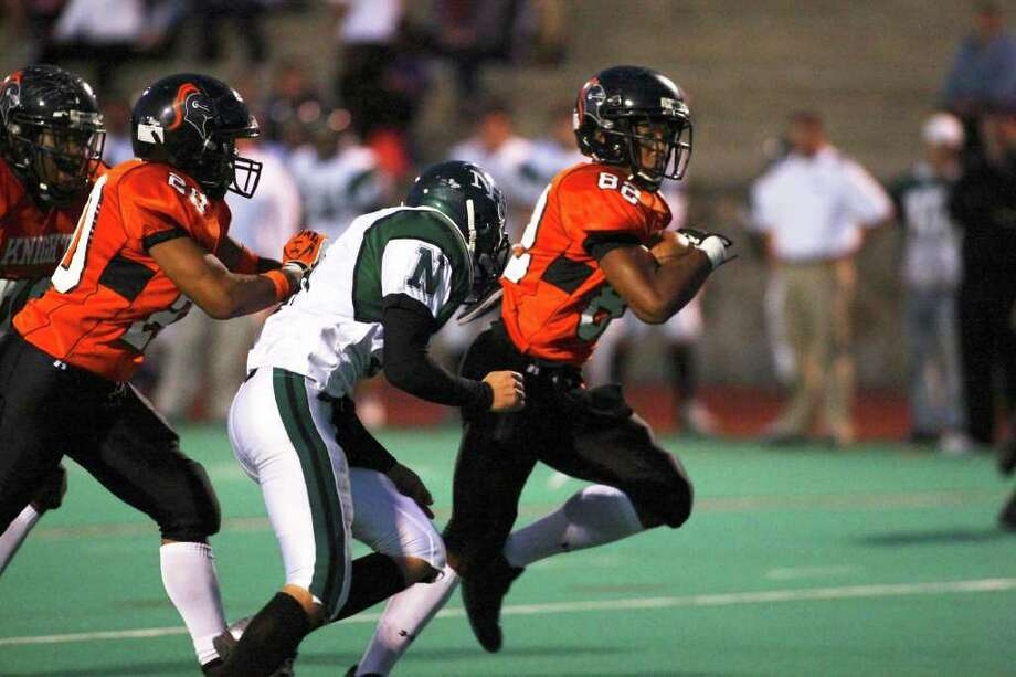 The Black Knight offensive line provided great protection, as Stamford marches downfield into the Red Zone Friday, October 8th in Stamford. Photo: David E. Johnston / Connecticut Post Freelance