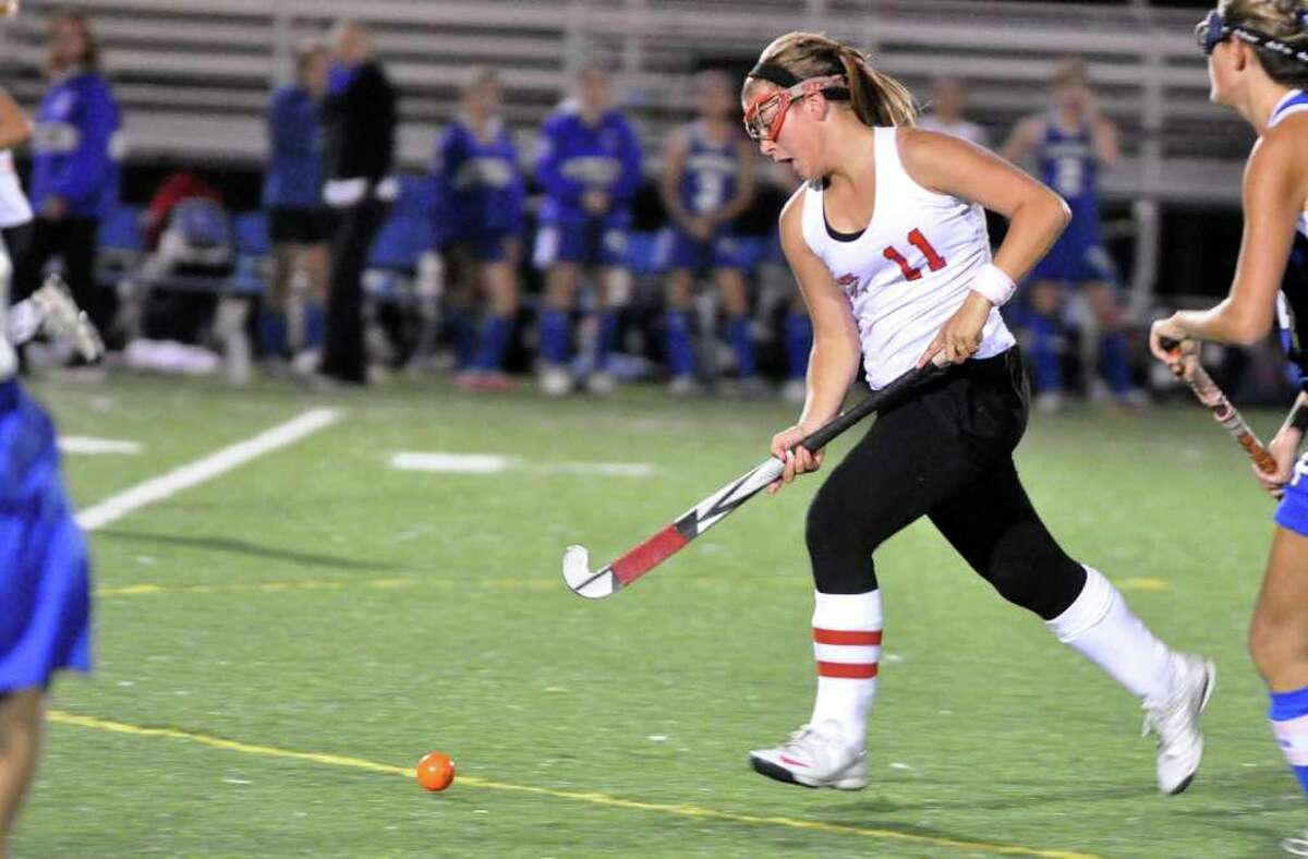 Fairfield Warde's Stacey DiLeo controls the ball during the field hockey game against Fairfield Ludlowe at Warde on Thursday, Oct. 7, 2010.