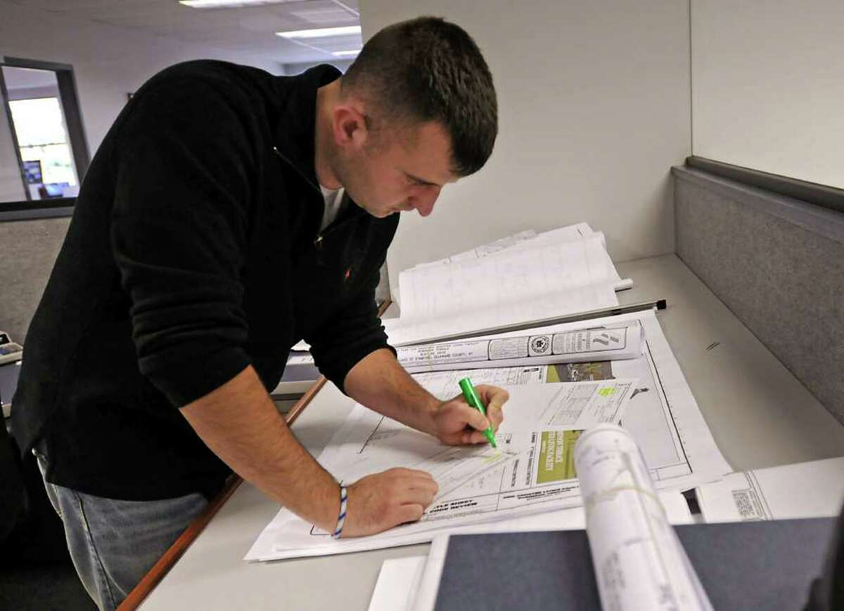 Pete Cornell, Assistant Project Manager, works on some plans at BBL Construction Services in Albany, NY on October 8, 2010. (Lori Van Buren / Times Union)