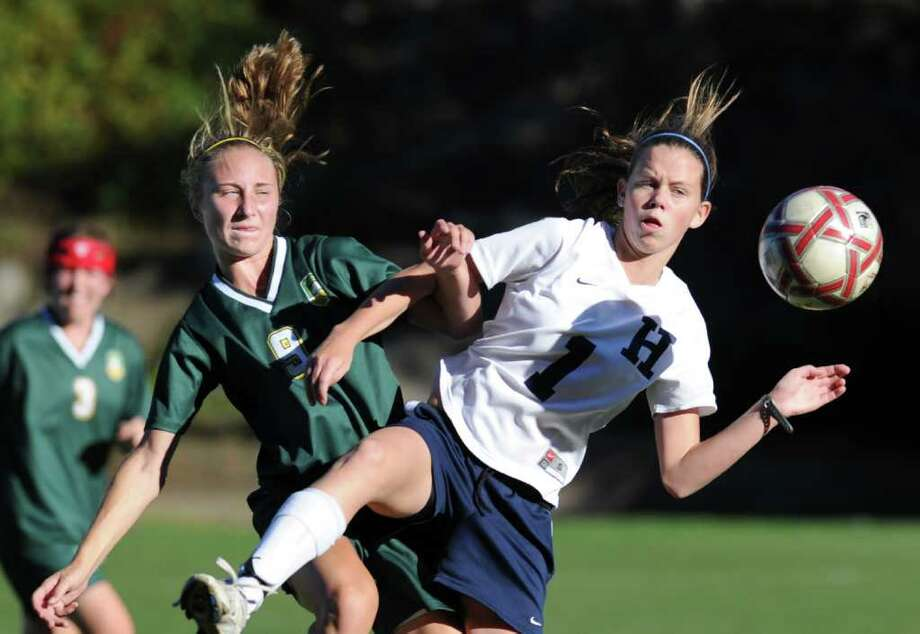 Hannah Withiam of the Greenwich Academy soccer team, left,  goes for the ball against Amie Dickson, # 1, of Hotchkiss School, during first half action of the Greenwich Academy vs. Hotchkiss School soccer match at Greenwich Academy, Saturday afternoon, Oct. 9, 2010.  Dickson is from Greenwich. Photo: Bob Luckey / Greenwich Time