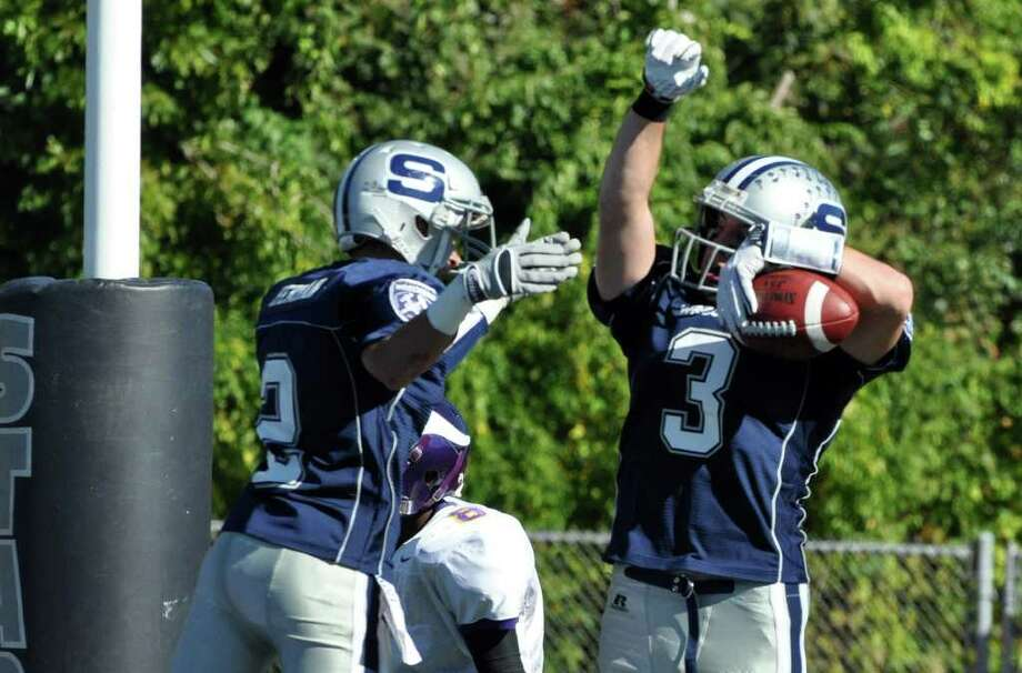 Staples' Robbie Herman congratulates teammate Jason Mawicke on a touchdown during the first half of the football game against Westhill at Staples on Saturday, Oct. 9, 2010. Photo: Amy Mortensen / Connecticut Post Freelance