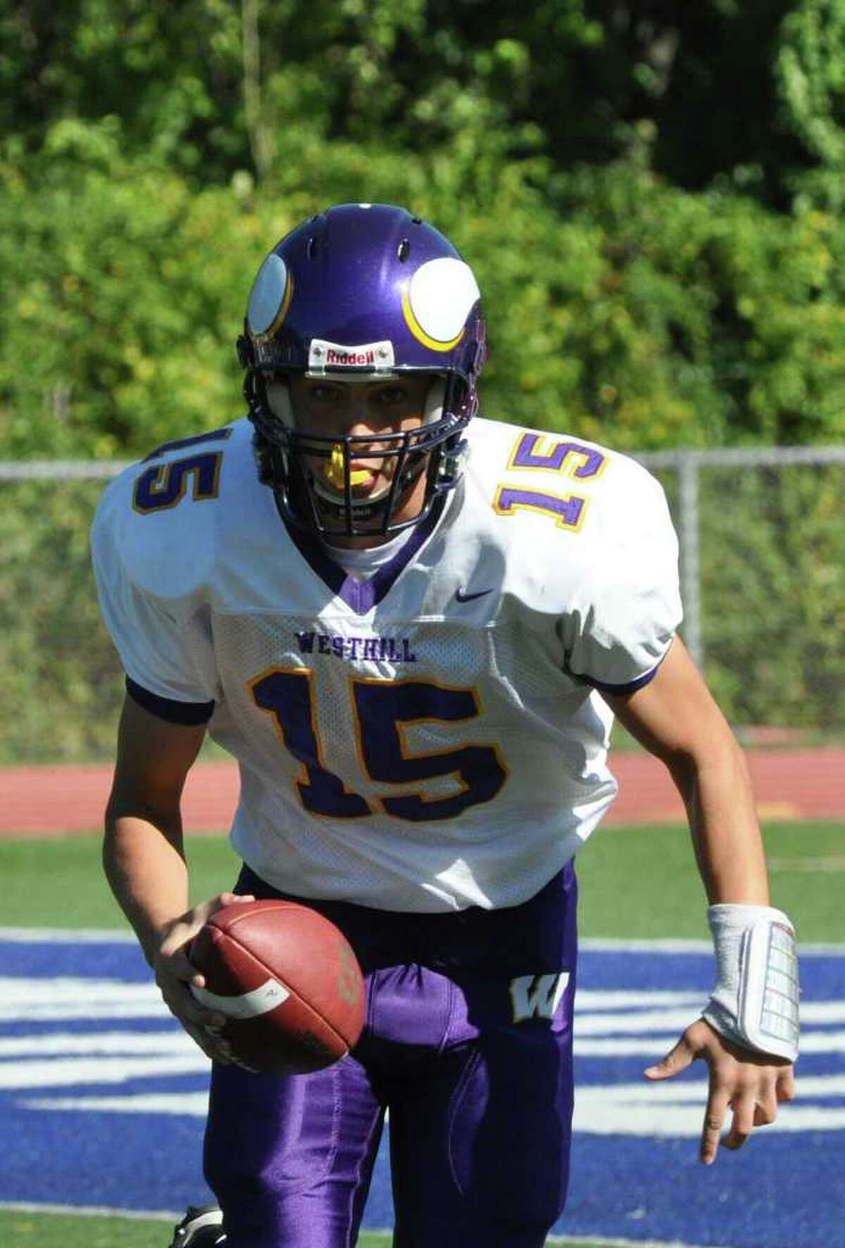 Westhill's Peter Cernansky carries the ball during the first half of the football game against Staples at Staples on Saturday, Oct. 9, 2010.