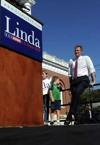 Massachusetts senator Scott Brown looks on as Linda McMahon speaks during a rally in Milford on Saturday, October 9, 2010. Photo: Lindsay Niegelberg / Connecticut Post