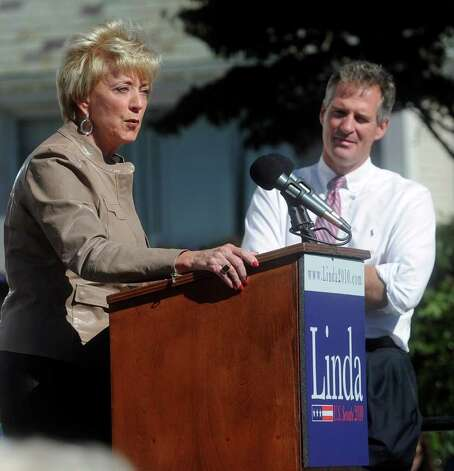 Linda McMahon speaks to supporters as Senator Scott Brown, R-Massachusetts, right, looks on during the Linda McMahon rally in Milford on Saturday, October 9, 2010. Photo: Lindsay Niegelberg / Connecticut Post