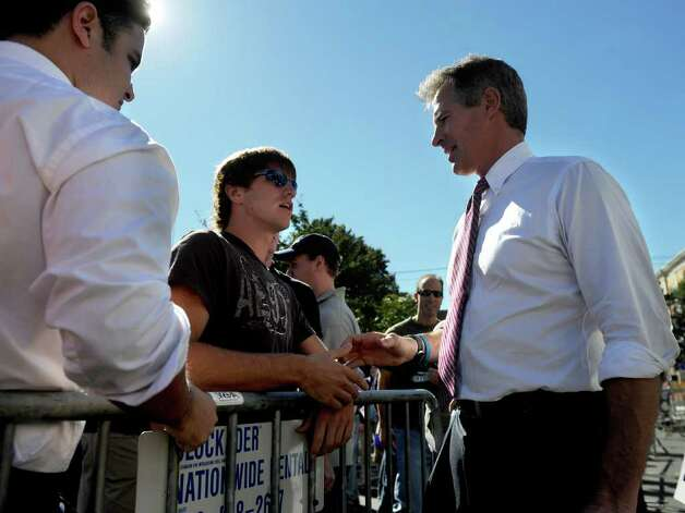 Senator Scott Brown, R-Massachusetts, shakes hands with McMahon supporters during the Linda McMahon rally in Milford on Saturday, October 9, 2010. Photo: Lindsay Niegelberg / Connecticut Post